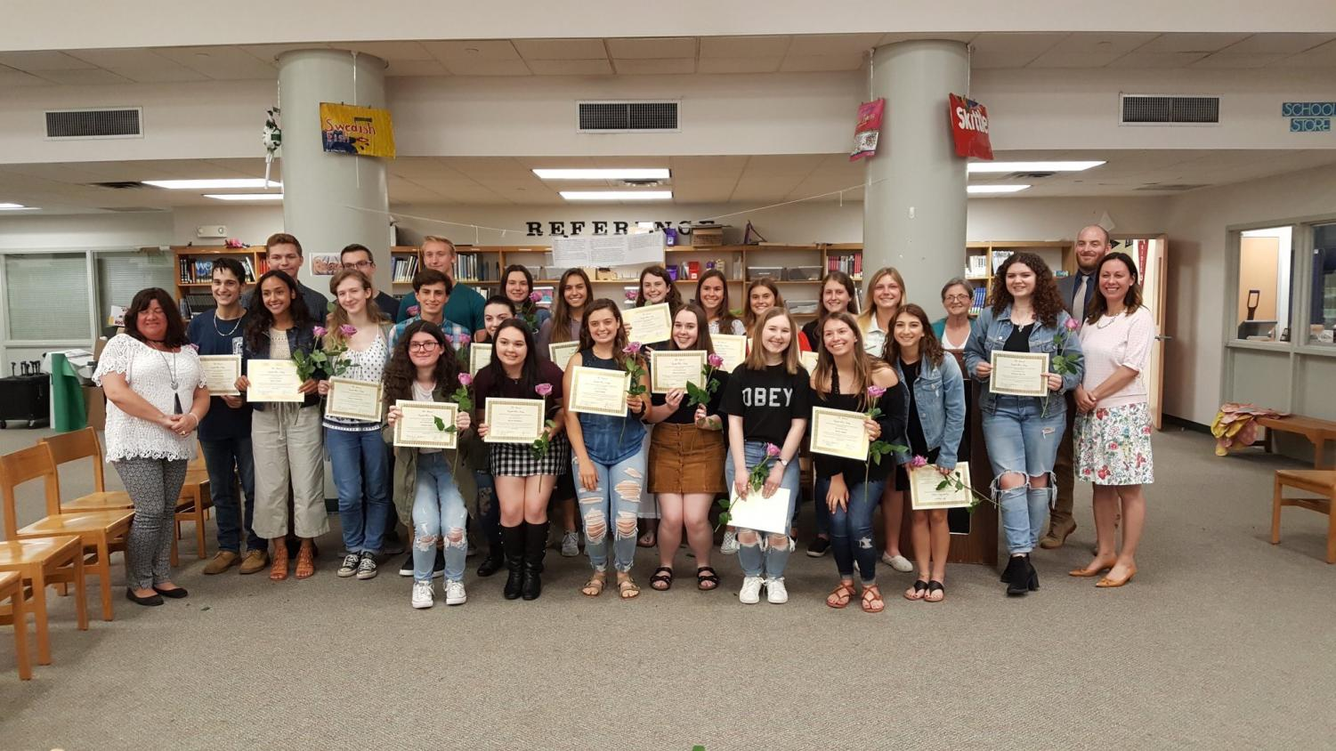 NEHS advisors welcome their newest inductees to the program.  Photo courtesy of Twitter.