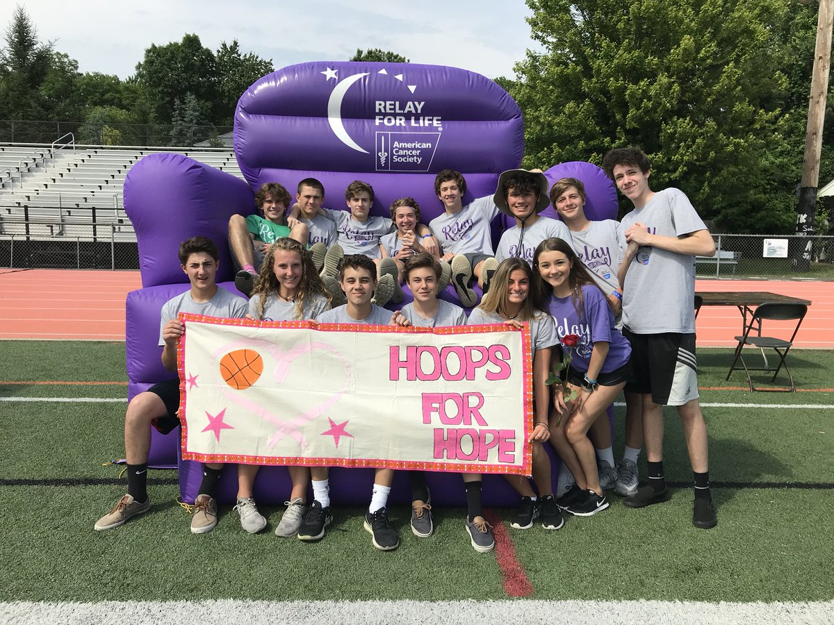 Team 'Hoops for Hope' showing off their creative banner.
