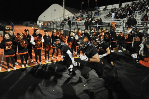 The Middletown North football team runs out on to the field prior to the NJSIAA Section II Group IV playoff game against Woodbridge held at Middletown North High School on November 11.